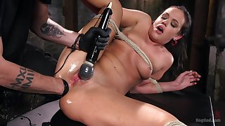 Torture master gets his hands on kinky brunette floosie Roxy Raye