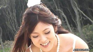 Off the chain cute Maiko Yoshida sucking her boyfriend's dig up on the shore