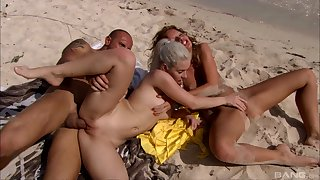 Bitches fuck at the beach coupled with plot the wet sperm load