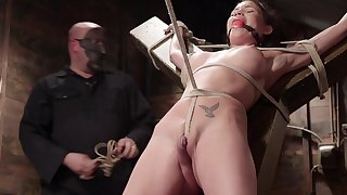 Raven Bay is expertly bound with rope and fucked with a fake dick