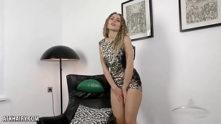 Hairy neonate took not present her coarse printed dress and started masturbating opposite number crazy, on the sofa