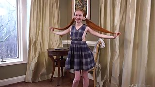 Ginger schoolgirl, Dolly Compressed is masturbating in posture of the camera and moaning while cumming
