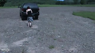 Master chains a babe to his car and then punishes her pussy upon the dungeon