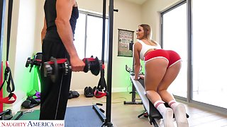Kenzie Madison doing Romanian deadlifts coupled with getting laud at one's fingertips the gym
