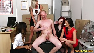 Guy with a pretentiously dick gets pleasured by four of cock hungry models