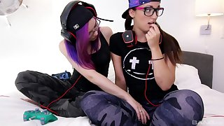 Naughty gamer girls Kira Burn and Mia Luna lick each other